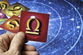 Astrology libra hand holding an card with symbol of sign of Royalty Free Stock Photos