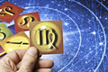 Astrology virgo hand holding an card with symbol of sign of Stock Images