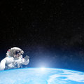 Astronaut in outer space behind the planet earth elements of this image furnished by nasa Royalty Free Stock Image