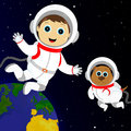 Astronauts boy and dog in costumes astronaut floating in outer space Royalty Free Stock Image
