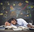 Astronomy class teacher sleeping on desk during Stock Photo