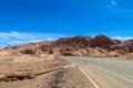 Atacama desert arid landscape and asphalt road Royalty Free Stock Photo