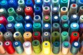 Atelier workshop. A set of colored threads for sewing on reels. A bunch of large multicolored spools of thread Royalty Free Stock Photo