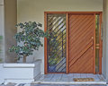 Athens greece house entrance building with solid wood door and parterre Stock Photography