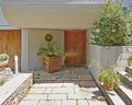 Athens greece house entrance with solid wood door and flowerpot Stock Image