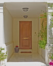 Athens greece house entrance with solid wood door and flowerpot Stock Photo
