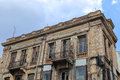ATHENS, GREECE - June 13, 2016: Old and dilapidated building undergoing renovation in downtown Athens, Greece