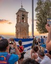 Military ceremony for the lowering of the Greek flag at sunset at Lycabettus Hill in Athens Royalty Free Stock Photo
