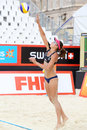 Athlete from brazil throws ball over net moscow june at tournament grand slam of beach volleyball on june in moscow russia Royalty Free Stock Photos