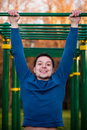 Athlete doing pull up on horizontal bar closeup of young strong Stock Image
