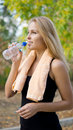 Athlete drinking bottled water Stock Image