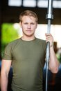Athlete holding barbell bar at gym portrait of confident male Royalty Free Stock Photography