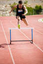 Athlete jumping above the hurdle Royalty Free Stock Photo