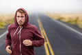Athlete man running training on road in fall sweatshirt hoodie autumn male runner outdoors jogging nature Stock Photos