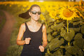 Athlete on morning jog in the sunflower s field cute Royalty Free Stock Image