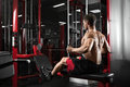 Athlete muscular bodybuilder training back on simulator in the gym Royalty Free Stock Photo
