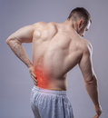 Athlete muscular man has pain in the back. Red
