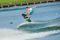 Athlete performing stunt during rip curl singapore national inter varsity polytechnic wakeboard championship july on Stock Image