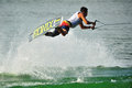 Athlete performing stunt during rip curl singapore national inter varsity polytechnic wakeboard championship july on Royalty Free Stock Images