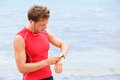 Athlete runner looking at heart rate monitor watch Stock Photography