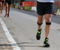 Athlete runner during the race with the bandage Royalty Free Stock Photo