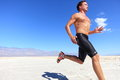 Athlete running sport - fitness runner in desert Royalty Free Stock Photo