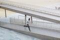 athlete runs a small bridge Royalty Free Stock Photo