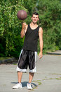 Athlete spinning basketball Stock Images
