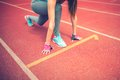 athlete on starting blocks at stadium track preparing for a sprint. Fitness, healthy lifestyle Royalty Free Stock Photo