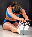 Athlete stretching legs Stock Photos