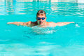 Athlete swimming butterfly stroke in a swimming pool male Stock Photography