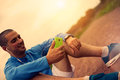 Athlete after training is studying results on a smartphone Royalty Free Stock Photo