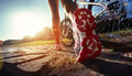 Athlete woman with her bike is running extreme mountain outdoors Stock Photography