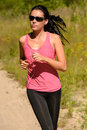 Athlete woman running training on sunny day with sunglasses Stock Image