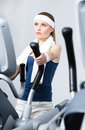 Athlete woman training on simulators in gym young Royalty Free Stock Images