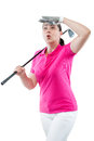 Athlete woman watching the ball flight path of golf on a white b Royalty Free Stock Photo