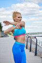 Athlete women s sportswear fit thin physique athletic build female outdoor city river Royalty Free Stock Image