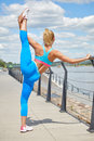 Athlete women s sportswear fit thin physique athletic build female outdoor city river Royalty Free Stock Photos