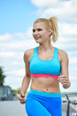 Athlete women s sportswear fit thin physique athletic build female outdoor city river Stock Photography