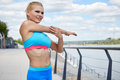 Athlete women s sportswear fit thin physique athletic build female outdoor city river Royalty Free Stock Photography