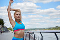 Athlete women s sportswear fit thin physique athletic build female outdoor city river Royalty Free Stock Images