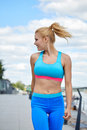 Athlete women s sportswear fit thin physique athletic build female outdoor city river Royalty Free Stock Photo