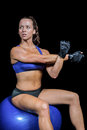 Athlete working out on exercise ball Royalty Free Stock Photo