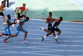 Athletes on the 4 x 100 meters relay race Stock Photo