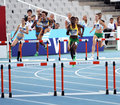 Athletes compete in the 400 meters hurdles race Royalty Free Stock Image