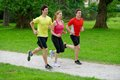 Athletes jogging in the park three young Stock Photography