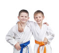 Athletes in a kimono and with different belts boys Stock Photos