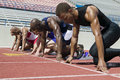 Athletes At A Starting Line On Racetrack Royalty Free Stock Photo