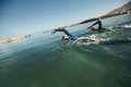 Athletes swimming on triathletic competition competitors swims freestyle in the water Stock Images