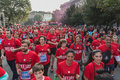 Athletes taking part in deejay ten running event organized by deejay radio in milan italy october take through the city streets on Royalty Free Stock Image